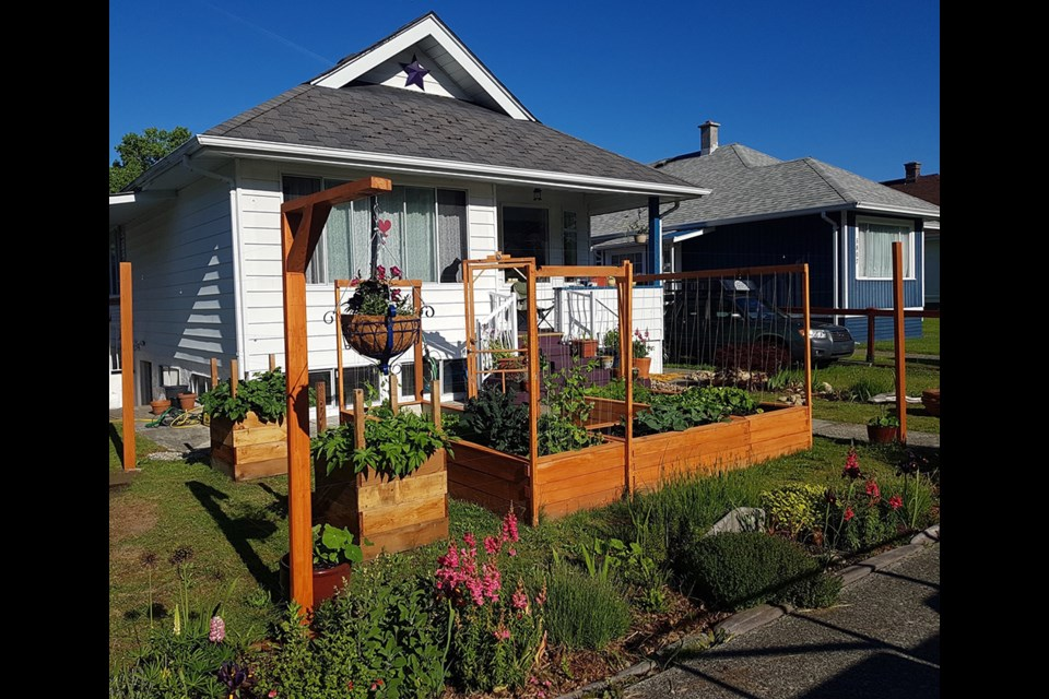 Homeowner Kate Dryden was recognized with the Best Kitchen Garden award for 2020 by Townsite Heritage Society.