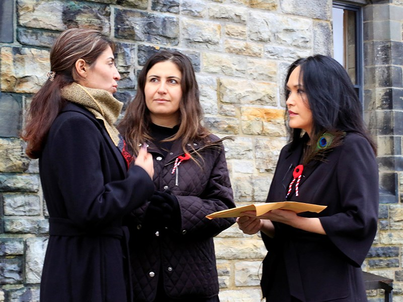 PLEADING FOR HELP: Yazidi refugee Adiba [left] with her Kurmanji interpreter Dilkhaz deliver a petition to the Canadian government asking for trauma counselling and other supports to be delivered as promised. MP Jenny Kwan [right] accepted the petition.