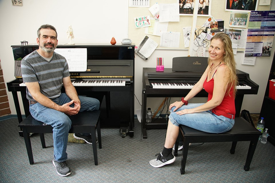 PREPARING PERFORMANCE: Sean Dees and piano instructor Ildiko Kelly worked on selections that he played at his end of year recital.
