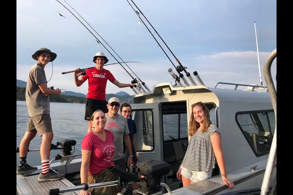 OFF-GRID AFICIONADOS: The Normandeau family on their boat, the Northern Twilight, fishing in Desolation Sound.