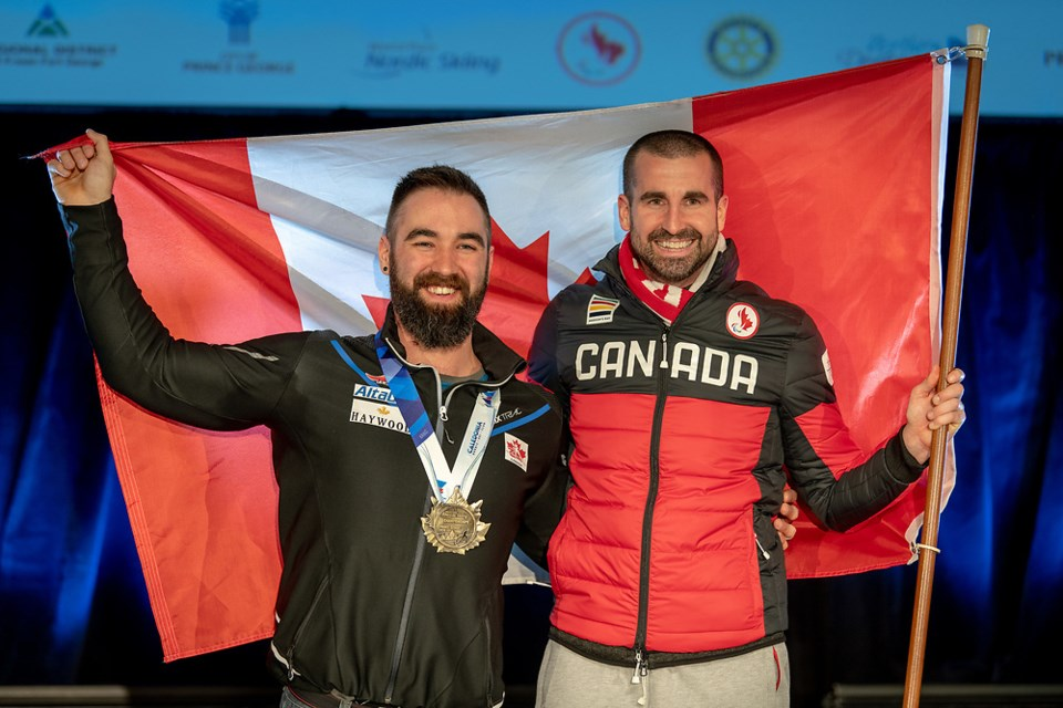Collin Cameron (left) celebrates his gold medal with his Canadian coach at the 2019 World Para Nordic Skiing Championships in Prince George (via Kelly Bergman)