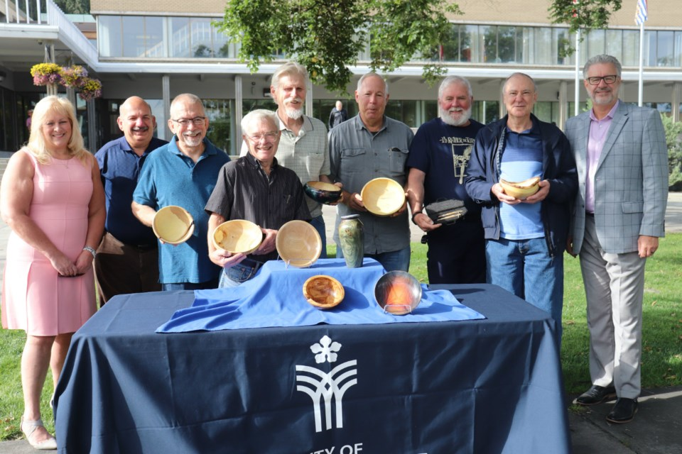 Spirit of the North Healthcare Foundation receives 12 pieces of woodwork that used to be trees in front of Prince George city hall (via Kyle Balzer)