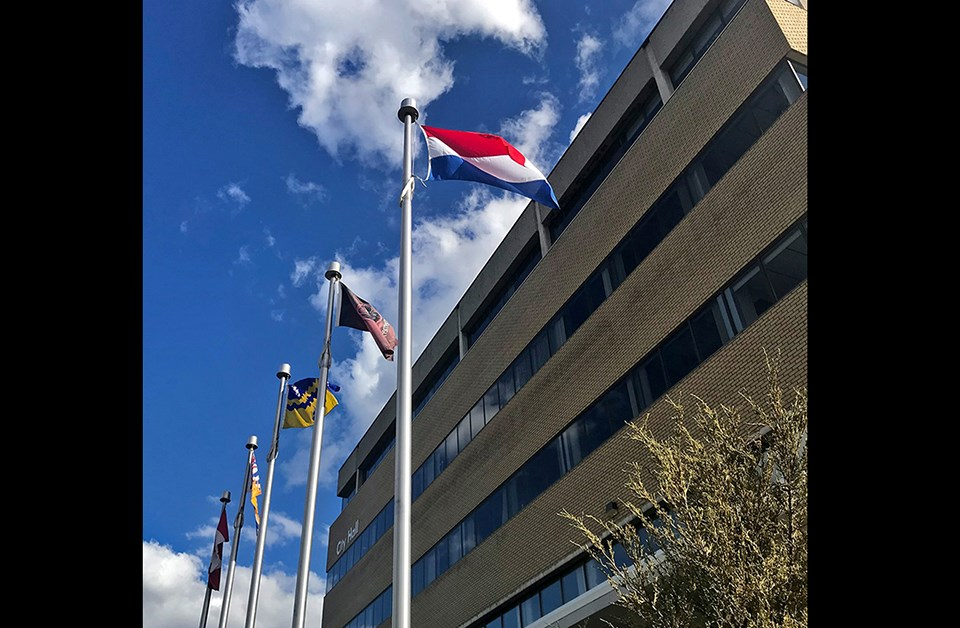 The flag of The Netherlands flies at Prince George city hall on May 5, 2020 to mark the 75th anniversary of the country's liberation. (via City of Prince George)