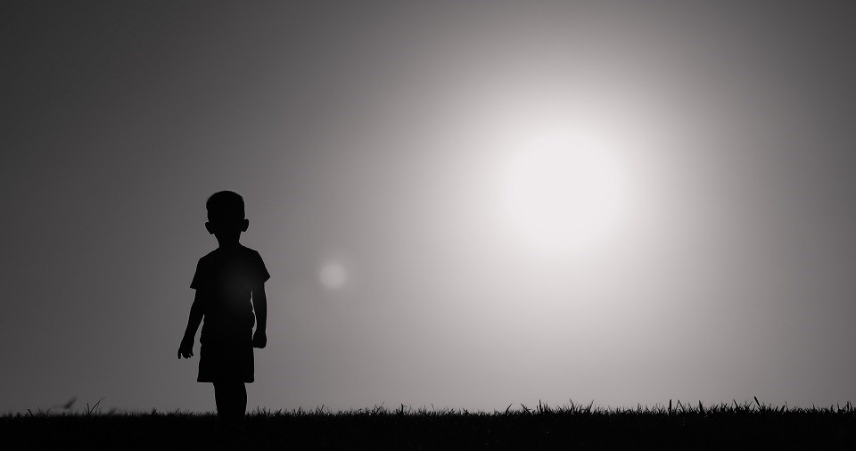 Young boy walking wandering alone - Getty Images