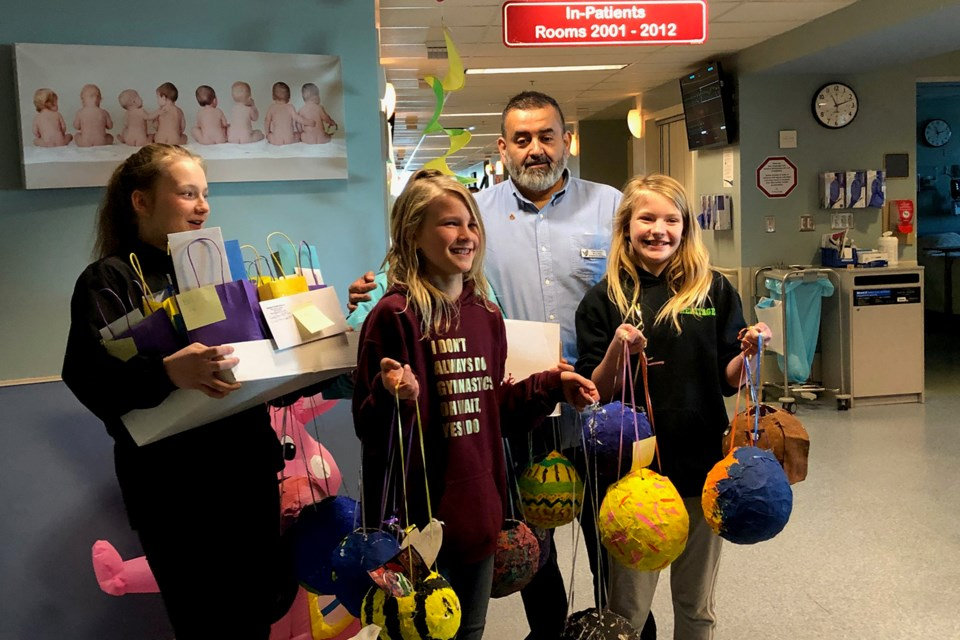 Heritage's Mr. Christian Silvia helped the girls to deliver the gifts (via Hanna Petersen)