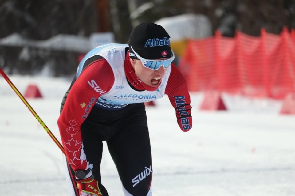 Mark Arendz (Canada) leans over in anxiety after winning the silver medal in the Men's Standing Long Distance biathlon at the 2019 World Para Nordic Skiing Championships in Prince George (via Kyle Balzer)