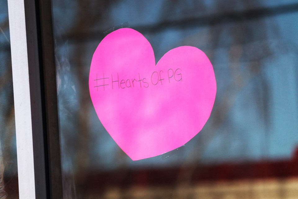 The windows of homes and businesses in Prince George have put hearts in their windows to bring the community together. (via Jess Fedigan)
