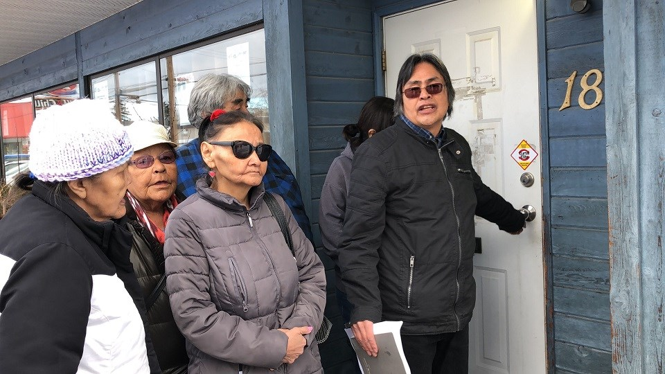 Mathew Joseph, who claims he's still the Chief of Yekooche First Nation, tries to open the door to the band's financial office in Prince George, but its locked (via Kyle Balzer)