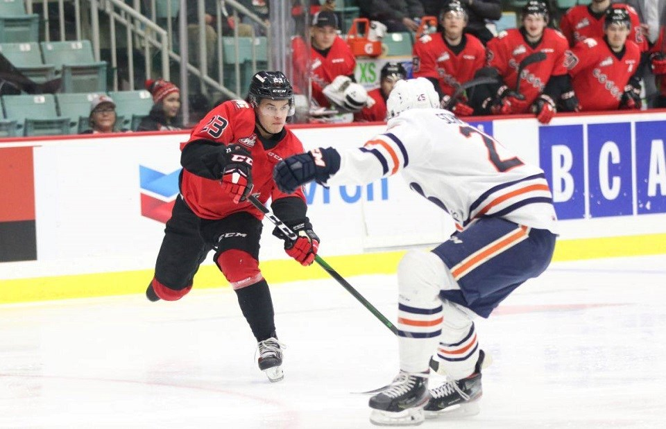 Filip Koffer (#23) tries to make a pass for the Prince George Cougars against Kamloops on home ice (via Chuck Chin Photography)