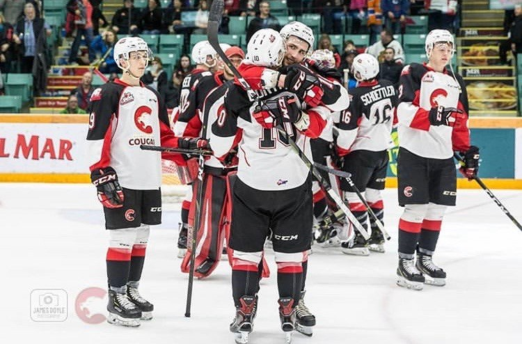 Cougars hug each other after the final buzzer of the last game of the 2018-19 season against the Kamloops Blazers (via Prince George Cougars/James Doyle Photography)