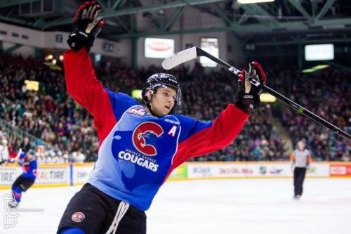 Brendan Guhle celebrates a goal at the CN Centre (via Prince George Cougars/Brett Cullen Photography)