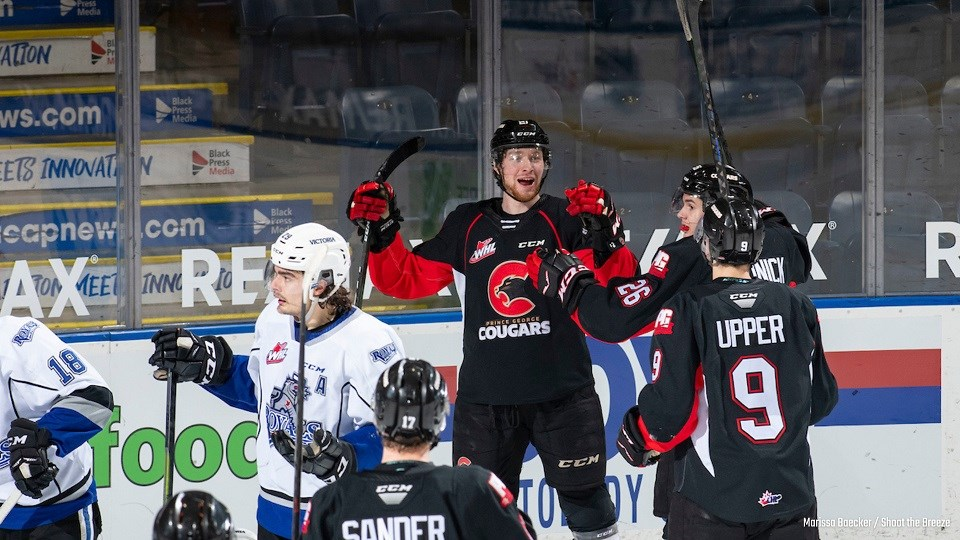 Prince George Cougars' Connor Bowie (#21) celebrates his hat-trick goal en route to a 5-3 win over Victoria.