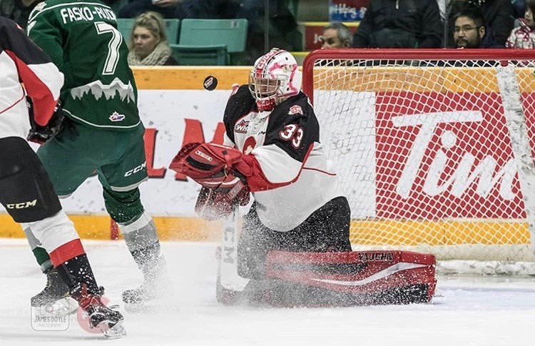 Isaiah DiLaura (#33) makes a save at the CN Centre against the Everett Silvertips (via Prince George Cougars/James Doyle Photography)
