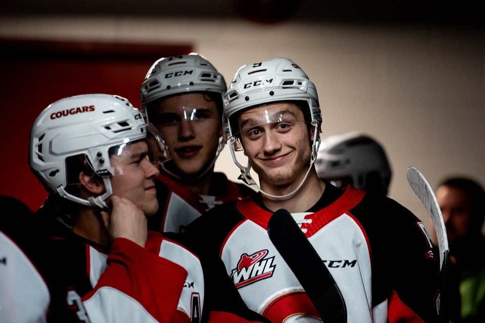 Tyson Upper (#9) smiles for the camera in the players' tunnel before a home game against Everett (via Prince George Cougars/Brett Cullen Photography)