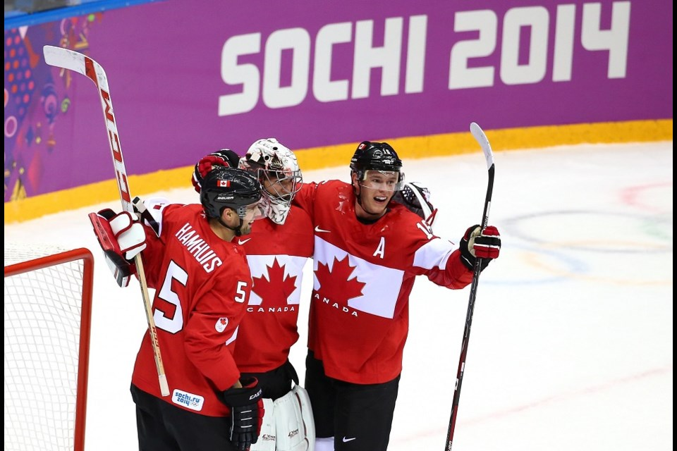 Dan Hamhuis (#5) celebrates a victory with Canada at the Sochi 2014 Winter Olympics. (via Getty Images)