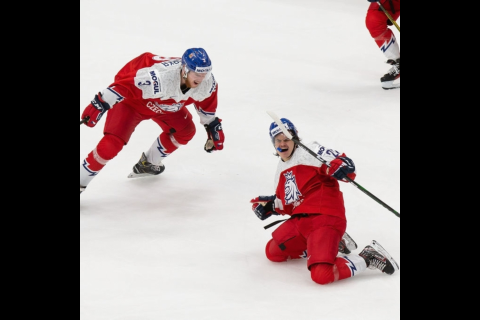 Prince George Cougars forward Filip Koffer (right) celebrates after scoring the eventual game-winning goal for the Czech Republic in a 2-0 win over Russia at the 2021 World Junior Hockey Championships in Edmonton.