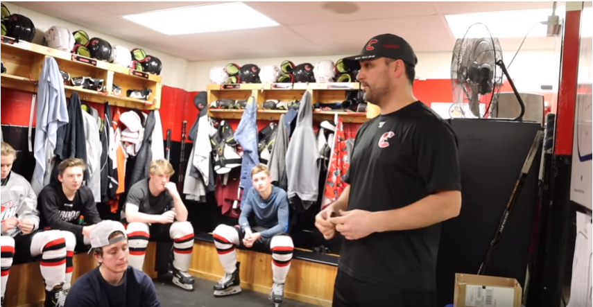 Cariboo Cougars Head Coach Tyler Brough talks with his team in the dressing room after a practice (via Marcus Allen)