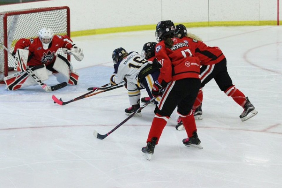 Northern Capitals in action against the Fraser Valley Rush in B.c. Female Midget AAA hockey (via Fraser Valley Rush)