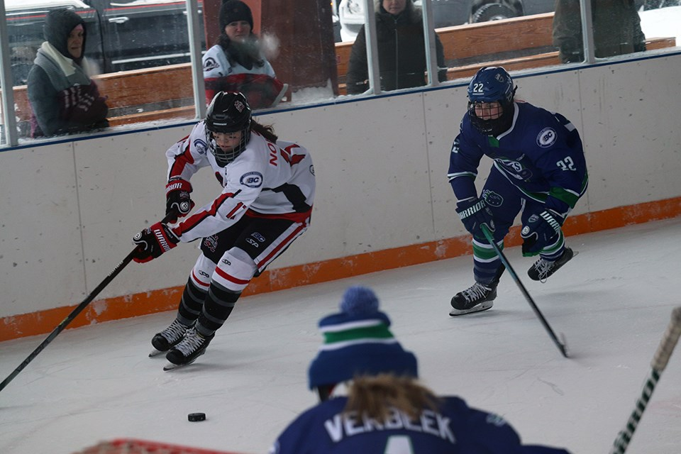 Northern Capitals' Brooke Norkus (#17) tries to get around a defender in the 2020 BC Winter Classic (via Kyle Balzer)