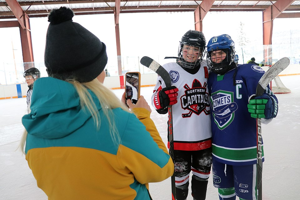 Northern Capitals' Brette Kerley (#8) poses for a photo with Greater Vancouver Comets captain Jenna Buglioni (#10) in the 2020 BC Winter Classic (via Kyle Balzer)