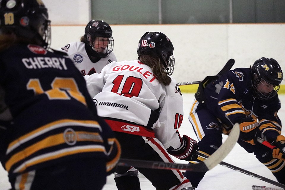 Keagan Goulet (#18) of the Northern Capitals us surrounded by defenders during her team's final 2019-20 weekend series played on home ice against the Fraser Valley Rush (via Kyle Balzer)