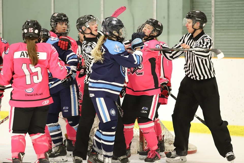 Northern Capitals' Paige Outhouse (#7) gets nudged by a Laker during Pink in the Rink Night (via Sharon Wells)