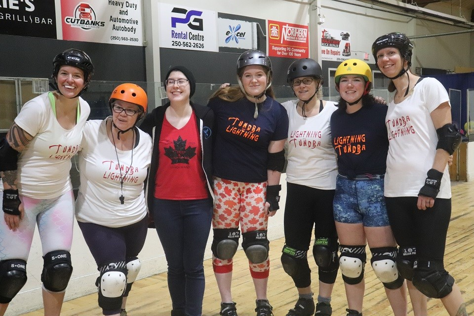Prince George roller derby athletes Dael King-Smith (middle) and Taylor Robinson (2nd right) are joined by family, teammates and supporters (via Kyle Balzer)