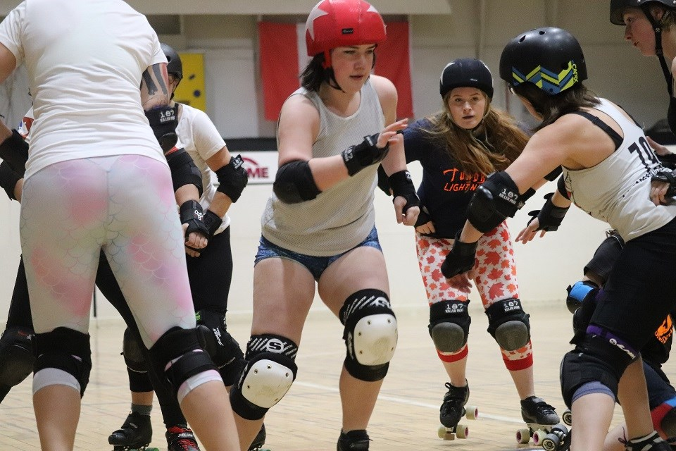 Dael King-Smith (2nd right), aka Tundra, and Taylor Robinson (middle), aka Lightning, in practice with Prince George's best roller derby athletes (via Kyle Balzer)