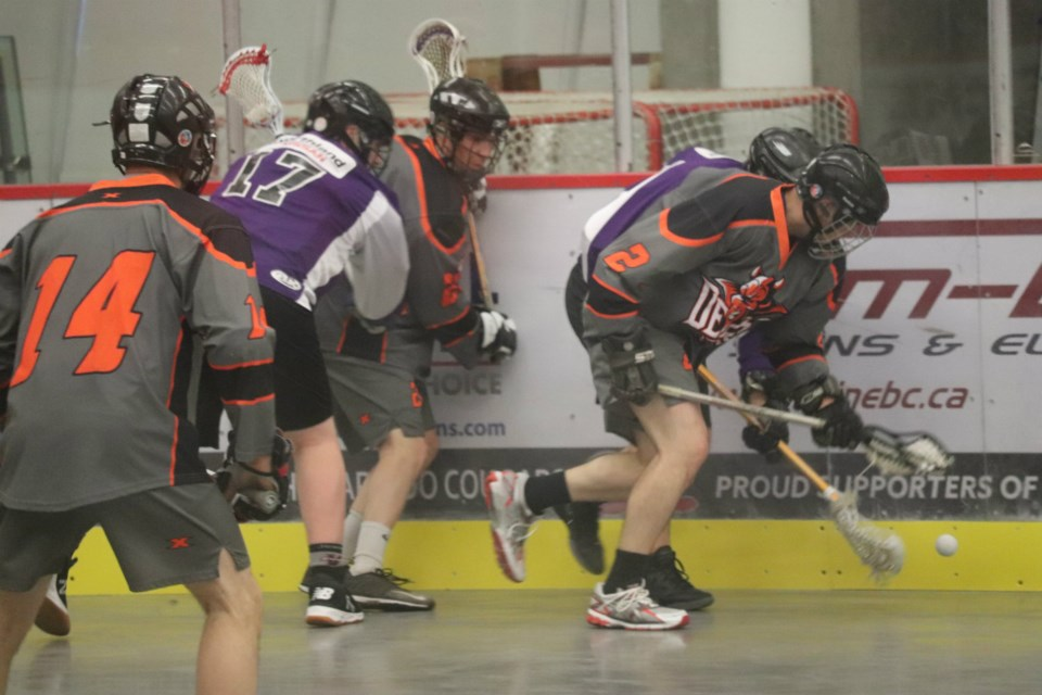 The Northland Nissan Assault and Westwood Pub Devils battle for the ball along the Kin Centre boards in the 2019 Prince George Senior Lacrosse Finals (via Kyle Balzer)