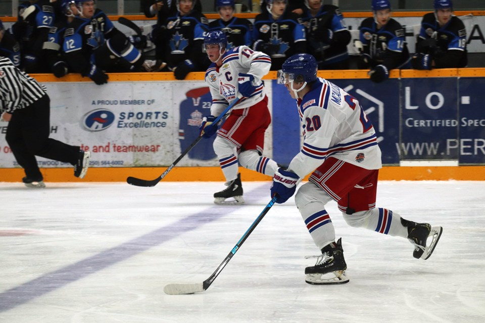 Ryan McAllister (#20) carries the puck up ice for the Prince George Spruce Kings (via Kyle Balzer)