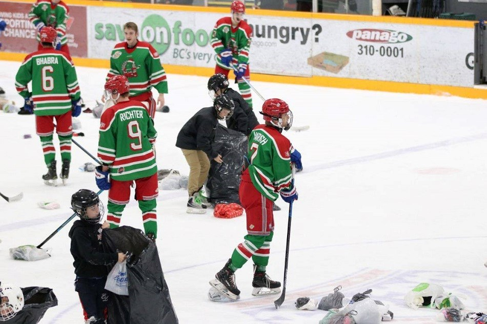 Prince George Spruce Kings clean up after scoring the Drop the Gloves, Sock it to 'Em goal against the Coquitlam Express (via Chuck Chin Photography)