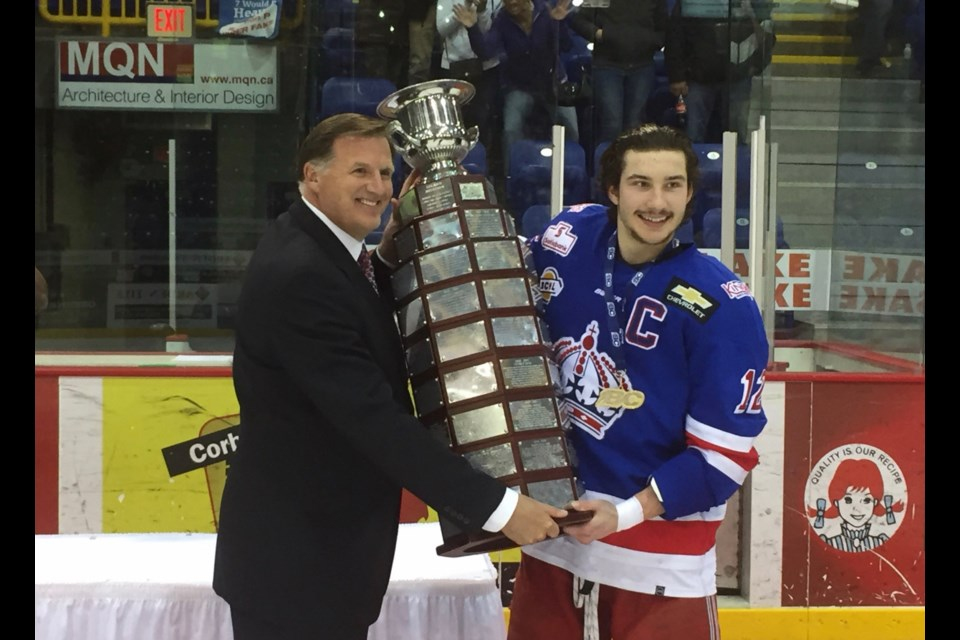 Prince George Spruce Kings captain Ben Poisson receives the Fred Page Cup from BCHL Commissioner Chris Hebb (via BCHL)