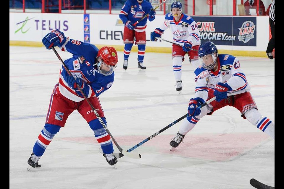 Fin Williams (#22) pokes for the puck against the Oakville Blades for the Prince George Spruce Kings (via Hockey Canada/Matthew Murnaghan)