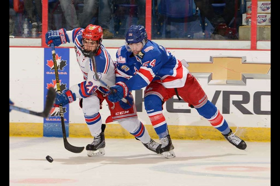 Nick Poisson (#24) tries to poke the puck away from the Oakville Blades during the Prince George Spruce Kings' 2019 National Championship semi-final match (via Hockey Canada/Matthew Murnaghan)