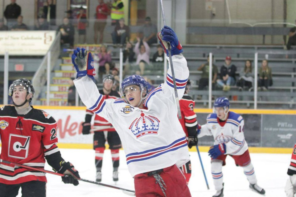 Brett Pfoh (#9) lifts his hands in celebration after scoring a goal for the Prince George Spruce Kings (via Chuck Chin Photography)