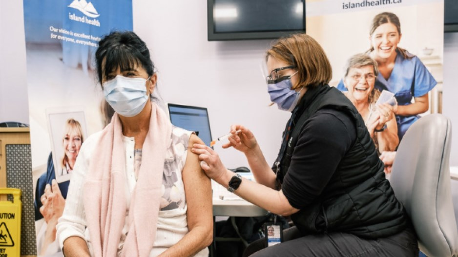 B.C.'s COVID-19 vaccine plan will require 715 full-time immunizers as it tries to administer 100,000 doses a day in the coming months.
