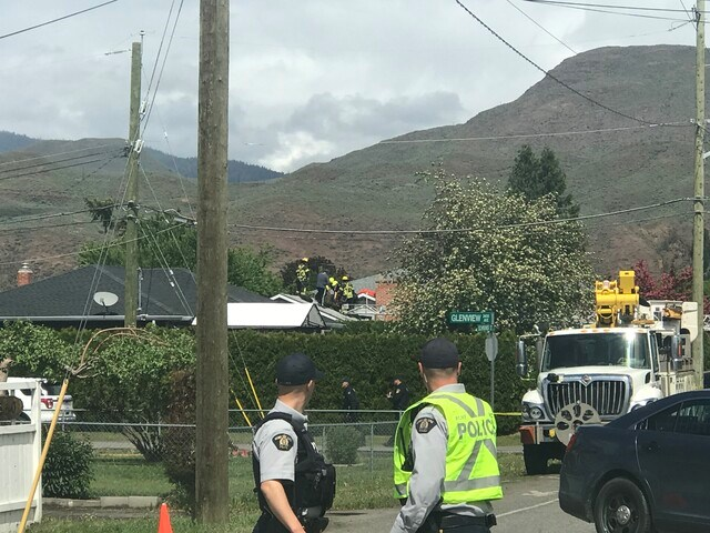 Rescue of a person on a roof after Snowbird plane crashes in Kamloops. (via Brendan Kergin)