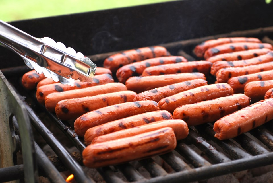 Hot dogs on barbecue