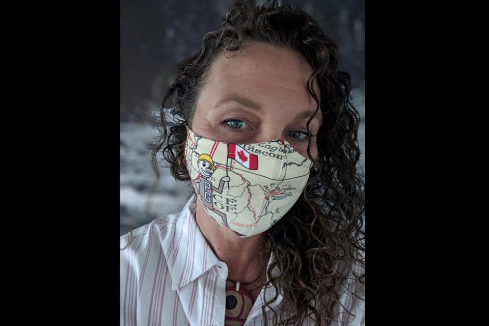 Prince George's Exploration Place has created face masks to help raise funds to support its Animal Ambassadors program in light of COVID-19, including one depicting Mr. PG seen here on CEO Tracy Calogheros. (via The Exploration Place)