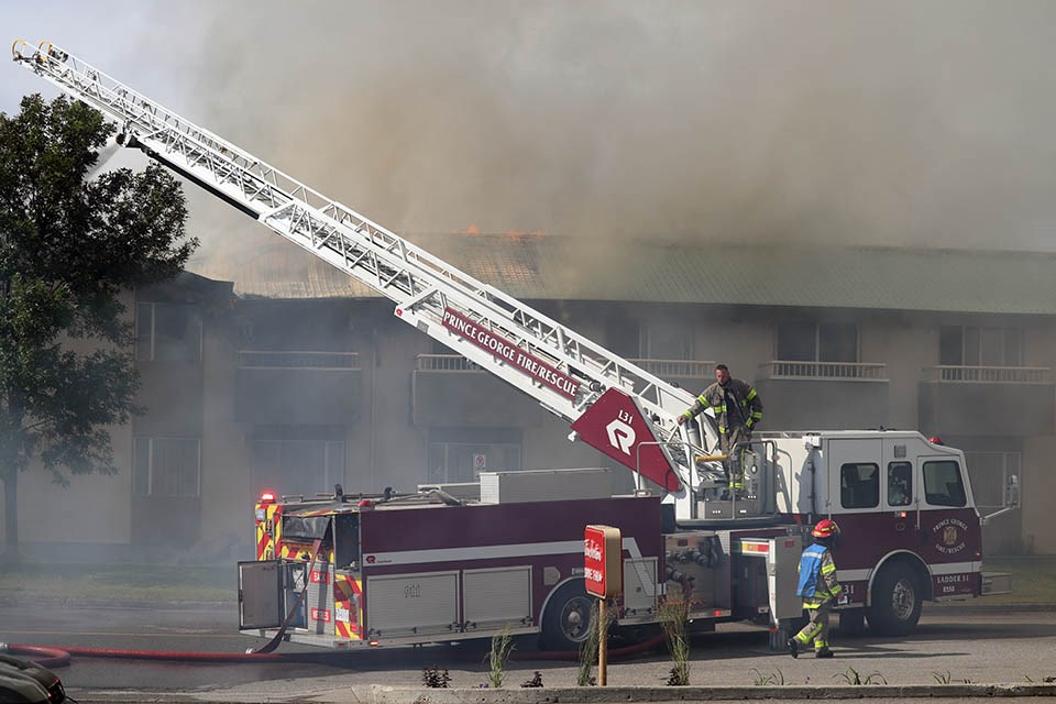 Prince George Fire Rescue crews battle a blaze engulfing the Econo Lodge near 15th Avenue and Victoria Street on July 8, 2020. (via Kyle Balzer, PrinceGeorgeMatters)
