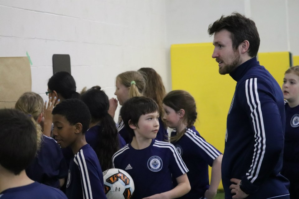 Vancouver Whitecaps Northern Academy Coach Austin Derksen preps his younger players for practice at UNBC's Northern Sport Centre (via Kyle Balzer)