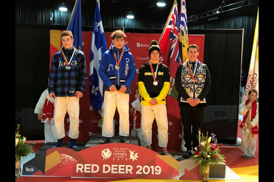 Lochlan Gary Young (right) of the Hart Judo Academy in Prince George on the podium with his bronze medal at the 2019 Canada Winter Games in Red Deer, Alberta (via Facebook/Hart Judo Academy)