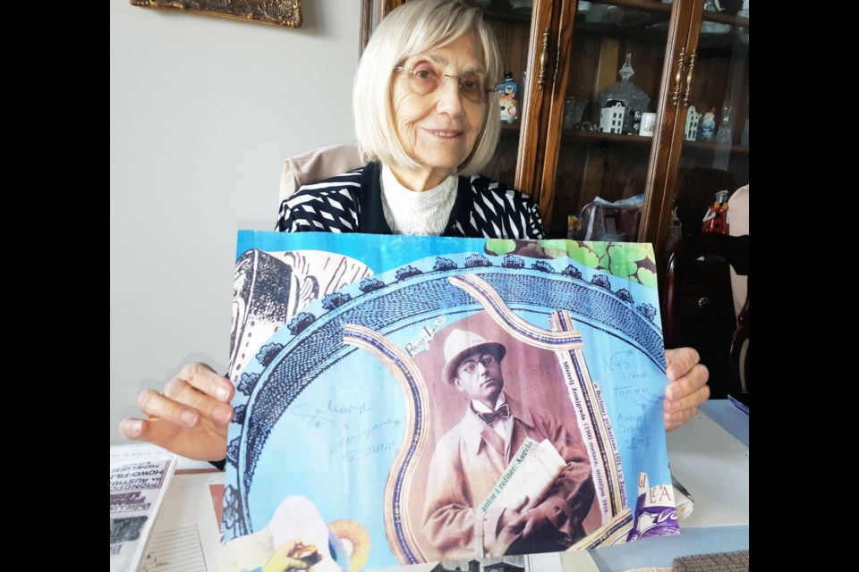 Nada Newell of Prince George holds a poster of her father, Franjo Ledic, whose work as a Yugosalvian film pioneer and movie studio owner was featured in an art exhibit in Zagreb, Croatia.