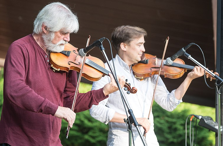 Gordon Stobbe, left, and JJ Guy, right, of Twin Fiddles perform in front of nearly one-hundred fiddle fans on Saturday evening at the Kiwanis Bowl in Lheidli T'enneh Memorial Park. The Twin Fiddles concert was hosted by the Prince George branch of the B.C. Old Time Fiddler's Association.