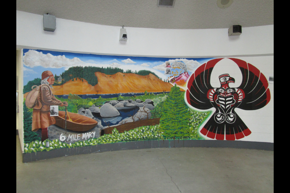 This is a part of a mural created on the walls of PGRCC by Dylon McLemore, a person in custody, as a way toward healing. This mural honours the iconic cutbanks, a part of the Lheidli T'enneh First Nation territory.