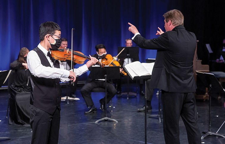 Citizen Photo by James Doyle/Local Journalism Initiative. 12-year-old Luke Chen solos on stage with the Prince George Symphony Orchestra as they recorded their final concert of the season, a presentation titled Splendorous Spring, on Saturday evening at Studio D.