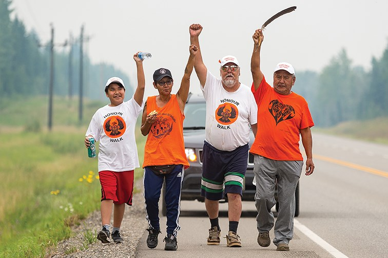 From left, Zaa Joseph from the Lheidli T'enneh, Patsy Seymour from the Lheidli T'enneh, Karle Nooski from Nadleh Whut'en, and elder Victor Joseph from Lheidli T'enneh, make their way along Highway 16 West as they head towards Prince George on Sunday while participating in the Walk Home from Lejac. The walk honored the ancestors and elders who made the journey trying to escape the residential school in Lejac. The walk started on Saturday morning at 10 a.m. from the site of the former residential school in Lejac and finished at the bandshell in Lheidli T'enneh Memorial Park at 4:30 p.m on Sunday afternoon.