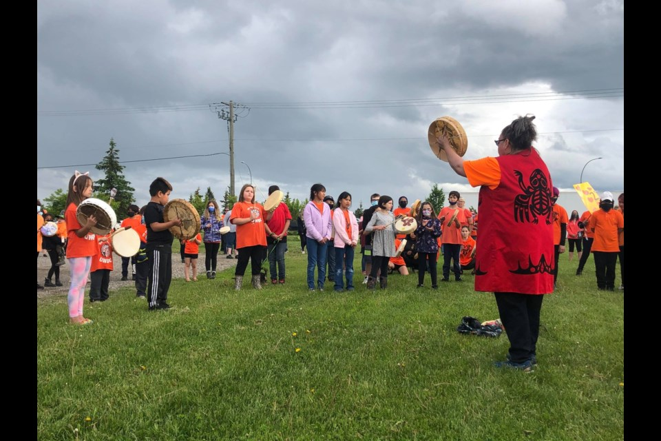 Hundreds gathered at the corner of Highway 16 and Ferry Avenue to honour 215 children discovered buried at Kamloops Residential School.