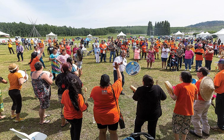 Citizen Photo by James Doyle/Local Journalism Initiative. Drummers play the closing song on Sunday afternoon during the final day of the Wiping of the Tears Healing Ceremony that was held on the site of the former Lejac Residential School.