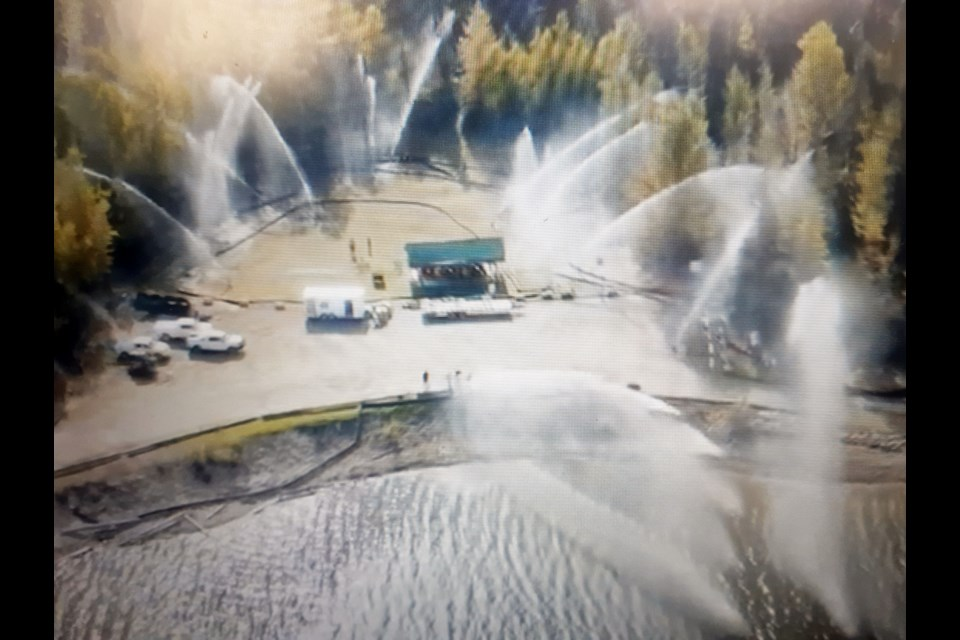 Safeguard, a wildfire fighting company based in Fort St. John, demonstrates how it uses its high-powered pumps and hoses to create a water curtain as a means to protect towns from destruction in wildfires. MLA Mike Morris says it's time the province declared a state of emergency to get resources like Safeguard involved in fighting the fires in B.C.